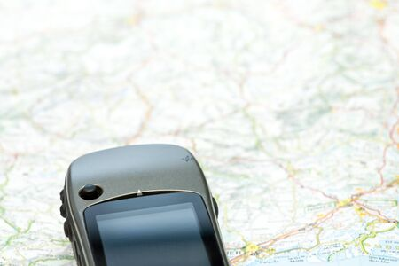 Hand-held GPS navigator on a map Stock Photo - 6089796