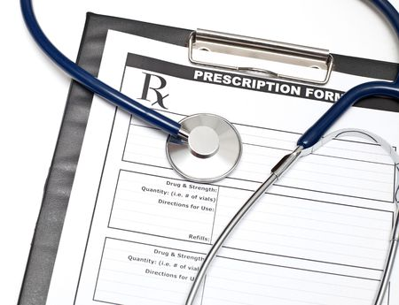 Blank prescription form on clipboard  with stethoscope photo