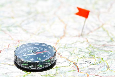 Compass on map with color flag pin in background Stock Photo - 6089807