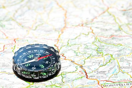 Navigation with compass and map, shallow focus Stock Photo - 6123483
