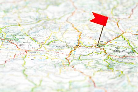 pin point: Red color flag pin on map, shallow focus