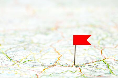 map pin: Red color flag pin on map, shallow focus