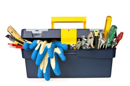 toolbox: Plastic workbox with assorted tools on white background Stock Photo