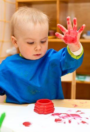 Little girl make finger paint photo