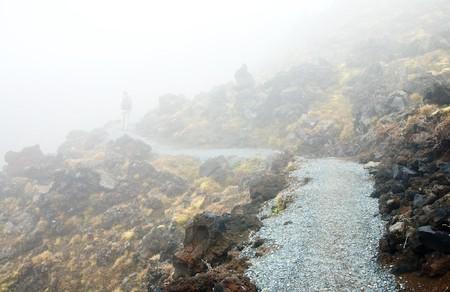 tongariro national park: Hiker walking on public track at Tongariro National Park, New Zealand