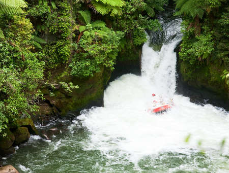 rafters: A group of whitewater rafters on the Kaituna River, New Zealand