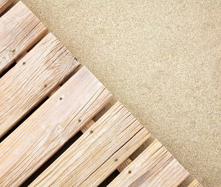 Weathered wooden boardwalk on  sand Stock Photo - 7022704