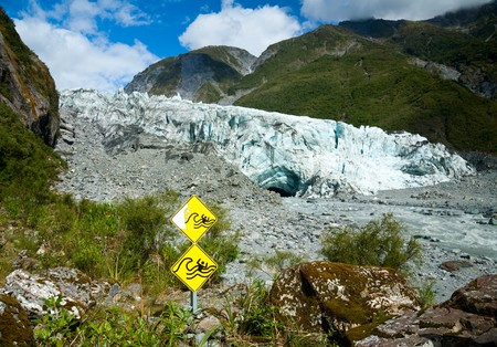 fox glacier: Warning signs at Fox Glacier terminal face Stock Photo