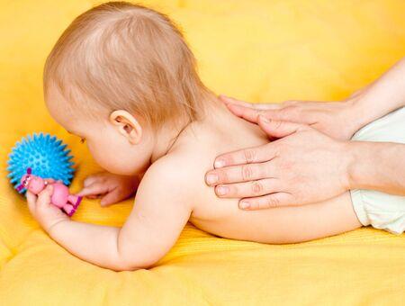 masseuse: Masseuse massaging little baby girl, shallow focus Stock Photo
