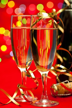 Two glasses of champagne with blured lights in background, very shallow DOF Stock Photo - 7424475