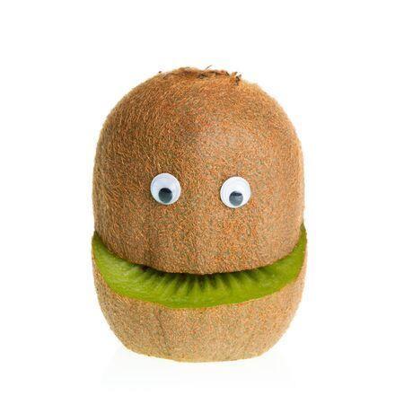 Funny fruit  character kiwi on white background photo