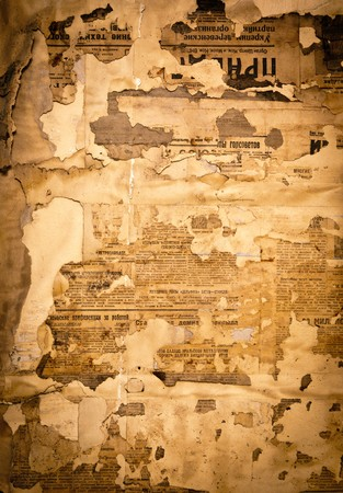 Grungy background with old yellowed Soviet newspaper fragments photo