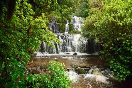 cascading: Cascading waterfall on the Purakaunui River in the South Island of New Zealand Stock Photo