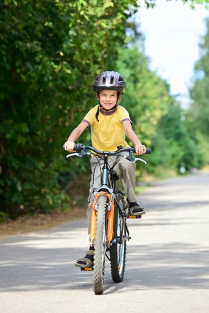 bicycle lane: Young boy riding bicycle on a summer day