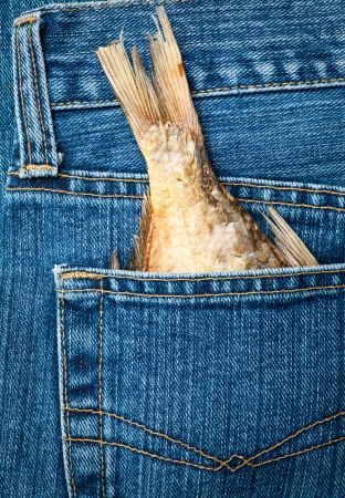 fish tail: Blue jeans pocket with dried fish tail