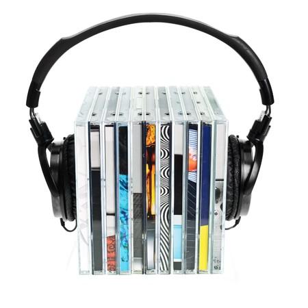 hifi: HI-Fi headphones on stack of CDs on white background Stock Photo
