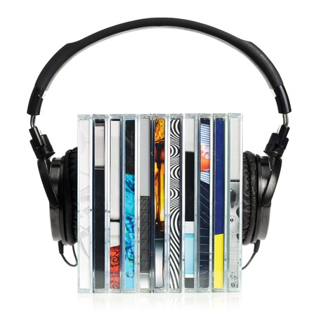 HI-Fi headphones on stack of CDs on white background photo