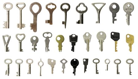 small group of objects: Collection of old keys on white background