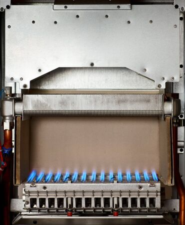 Gas flame inside of the gas boiler photo