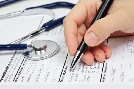 healthcare: Hand with pen over blank Prescription form with patient information