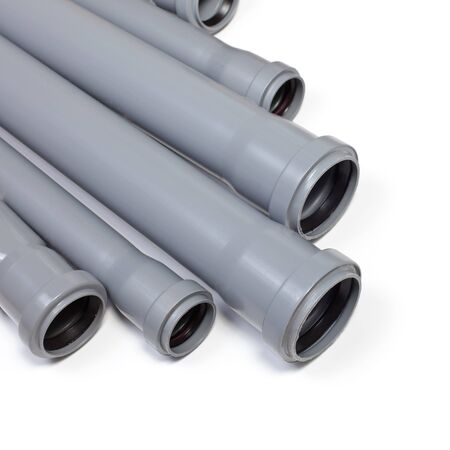 Grey PVC sewer pipes on white background photo