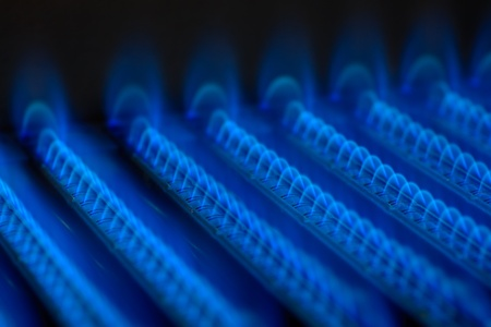 Blue flames of a gas burner inside of a boiler photo