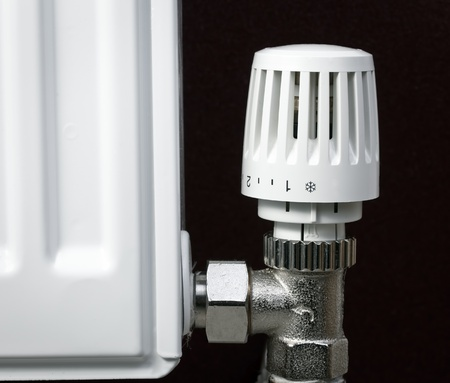 radiator: Thermostatic radiator valve set to minimal temperature close-up