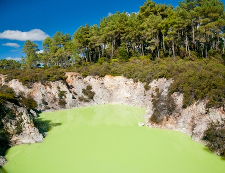 Devils Cave pool at Wai-O-Tapu  geothermal area in  New Zealand photo