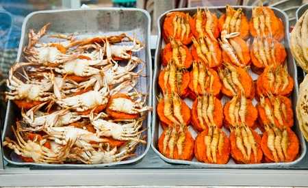 Spicy flat cakes with crabs and prawns on dishes in Colombo city, Sri Lanka Stock Photo - 9176979