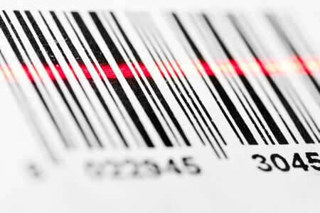 barcode scanning: Barcode scanned by laser reader closeup Stock Photo