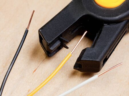 An automatic wire stripper with stripped copper wires photo