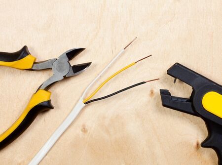 An automatic wire stripper with diagonal pliers and stripped copper wires photo