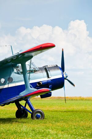 historic and vintage: Vintage single-engine biplane aircraft ready to take off
