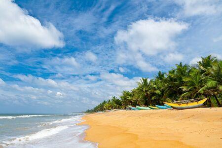 Fishing boats resting on empty beach in Sri Lanka Stock Photo - 9412235