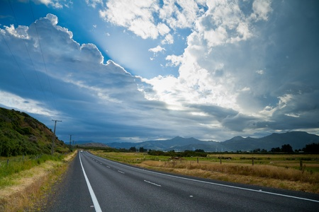 wide open: Country road with dramatic sky in the South Island of New Zealand