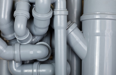 sewer pipe: Grey PVC sewer pipes background Stock Photo