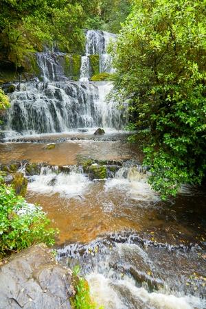 Cascading waterfall on the Purakaunui River in the South Island of New Zealand Stock Photo - 9576097