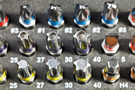 Various fastener bits in a box close-up photo