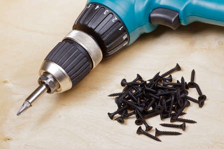Cordless drill with screws DIY background Stock Photo - 9624465