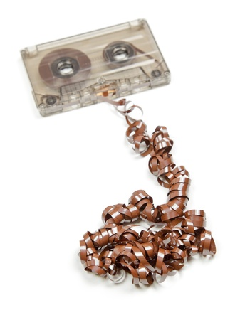 Vintage transparent Compact Cassette with pulled out tape on white background Stock Photo - 9708956