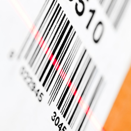 Barcode scanned by laser reader closeup Stock Photo