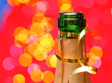 bottleneck: Champagne bottleneck with blured lights in background.