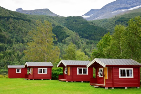 Red wooden cabins at campsite in Norway