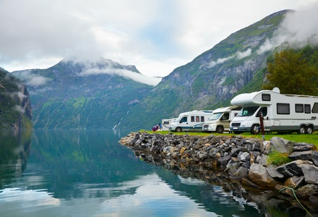 Motorhomes at campsite by the Geirangerfjord in Norway photo