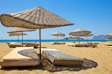 turkey beach: Sun loungers on a beach in Turkey Stock Photo