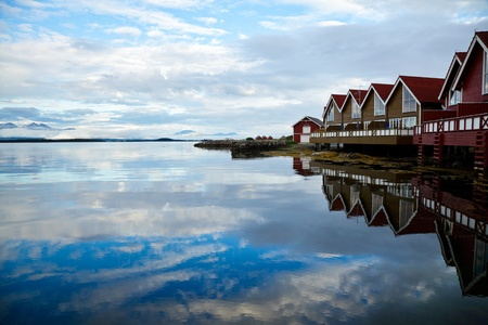 Red wooden cabins  at campsite by the fjord in Molde, Norway photo