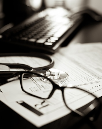 Stethoscope on a prescription form with glasses pen and keyboard, very shallow DOF Stock Photo - 10818289
