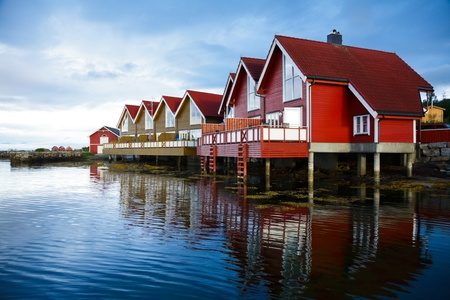 lake shore: Red wooden cabins at campsite by the fjord in Molde, Norway
