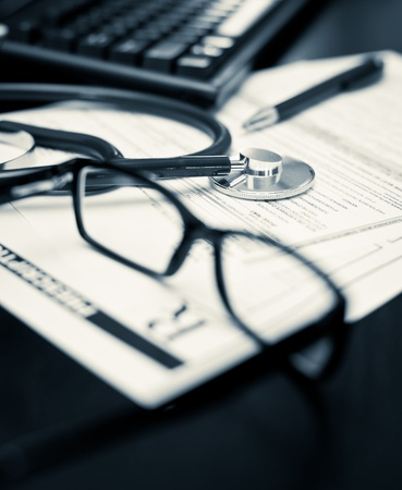 Stethoscope on a prescription form with glasses pen and keyboard, very shallow DOF Stock Photo - 10873175