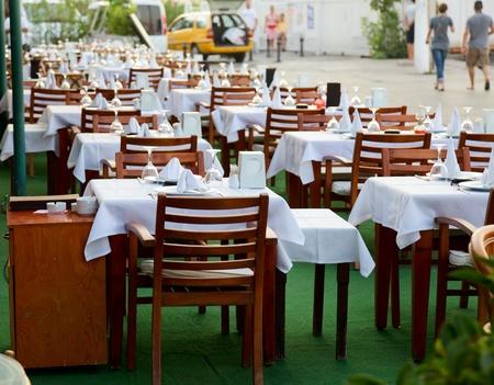 alfresco: Empty tables of a street restaurant in Turkey —  crisis concept